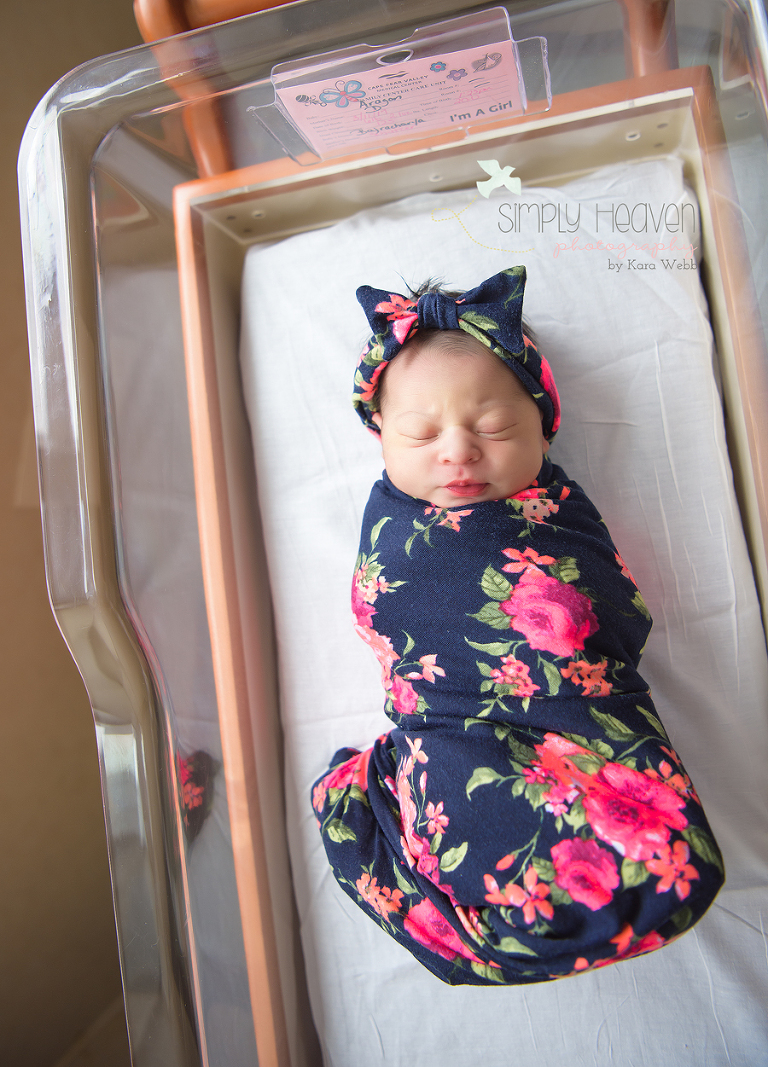fayetteville fresh48 picture of a newborn baby girl in a crib bassinet